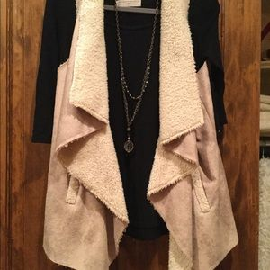 Soft Suede vest with pockets.